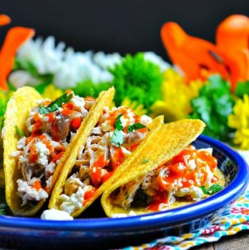 Buffalo ranch chicken tacos from a slow cooker on a plate