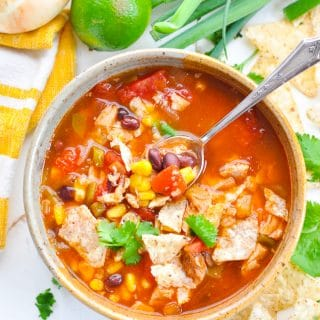 easy chicken tortilla soup in a bowl with a spoon
