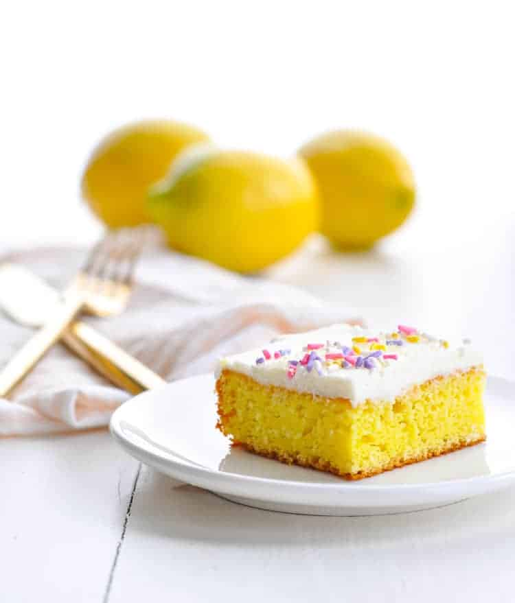 An easy lemon dessert recipe, Frosted Lemon Bars, sitting on a white plate.
