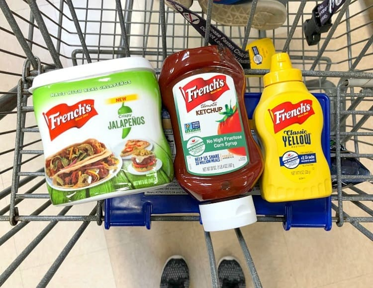 An overhead shot of french's mustard, ketchup and jalapenos in a shopping cart