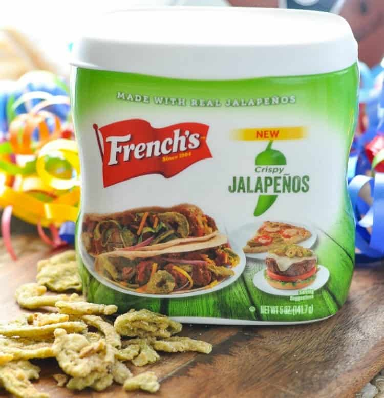 A photo of french's crispy jalapenos sitting on a wooden surface used to make pretzel dogs