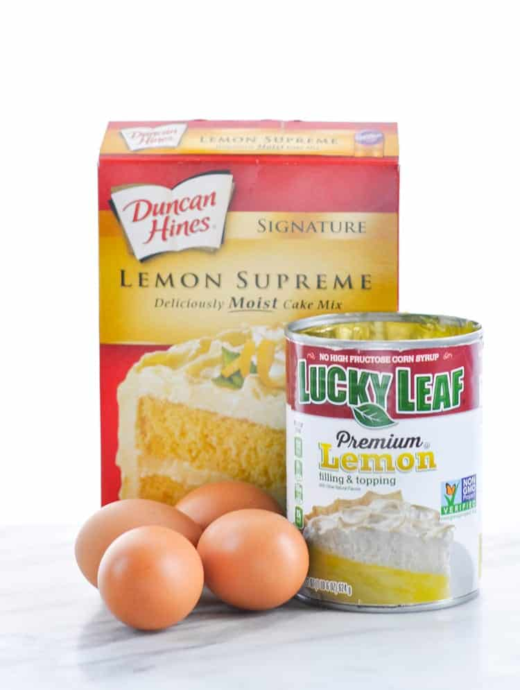 The three ingredients for easy lemon bars -- lemon cake mix, lemon pie filling, and eggs.