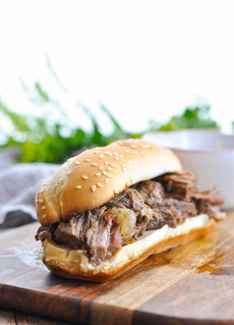 Photo of slow cooker French Dip sandwich on cutting board