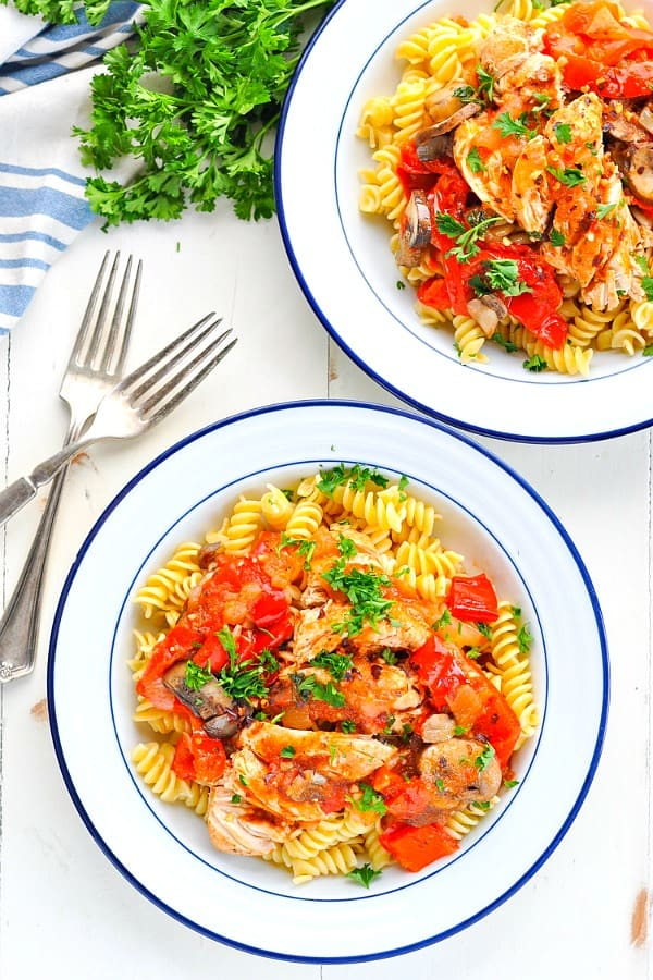 Overhead photo of two bowls of pasta with Instant Pot Chicken with Peppers Onions and Mushrooms