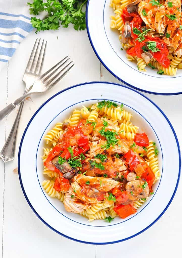 Overhead image of bowl of pasta with Italian chicken and peppers and onions