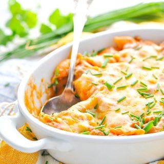 Cheesy beef taco pasta in a white casserole dish