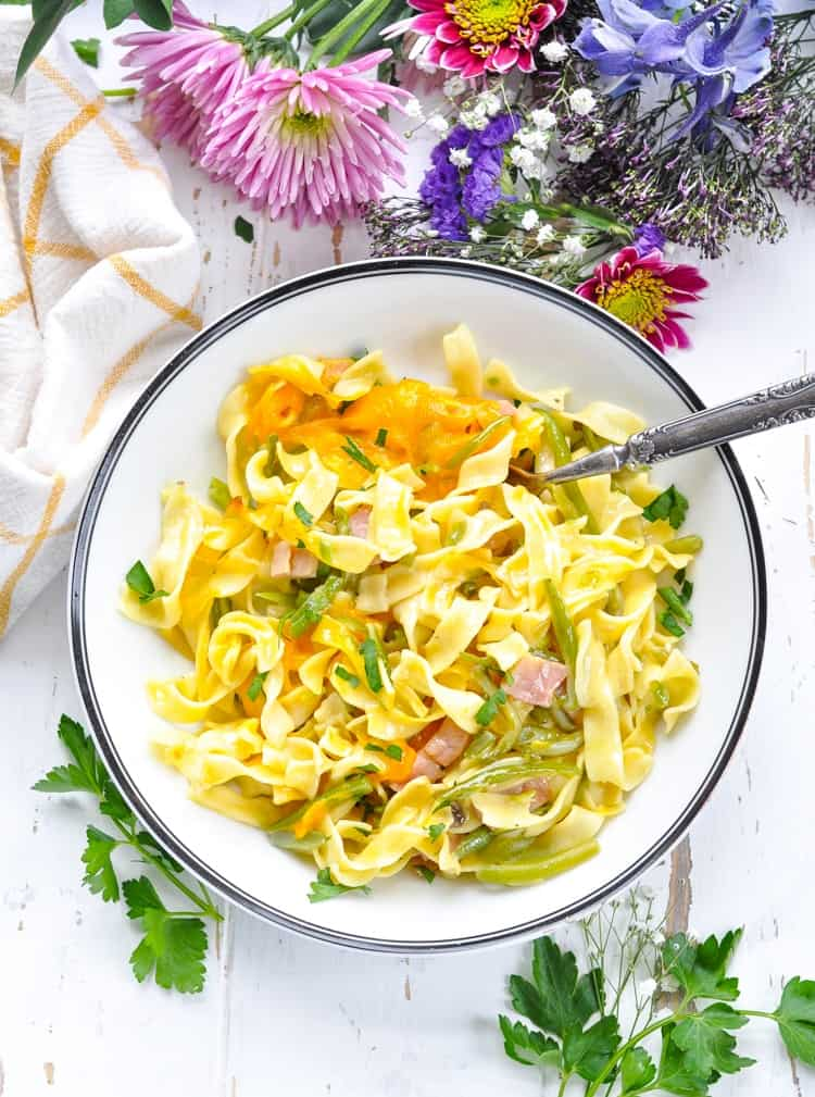 Overhead image of spring pasta with ham and green beans in a bowl