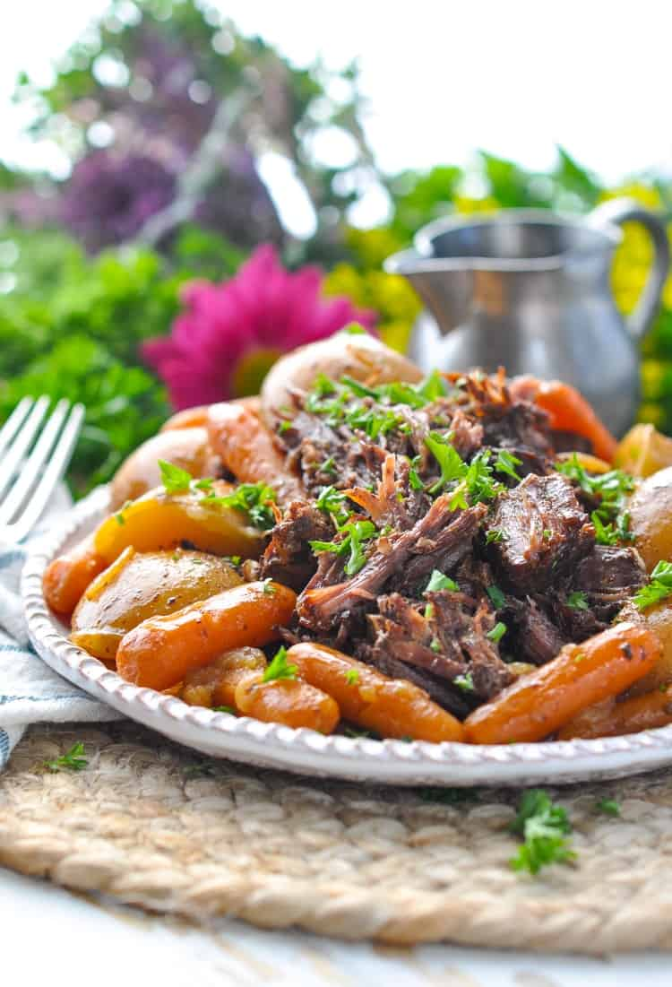 Slow Cooker Pot Roast with carrots and potatoes on a serving plate