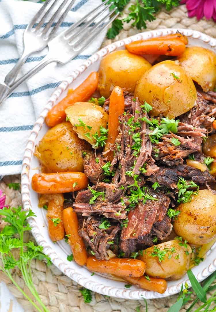 Overhead photo of pressure cooker pot roast close up on a plate with vegetables
