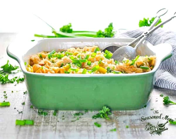 Horizontal front shot of a green dish of dirty rice and chicken