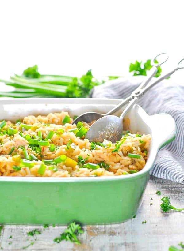 Zatarain's Dirty Rice baked with chicken in a green casserole dish