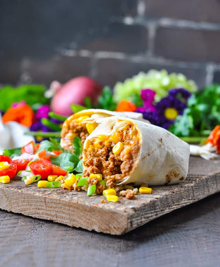 Beef burrito on a cutting board