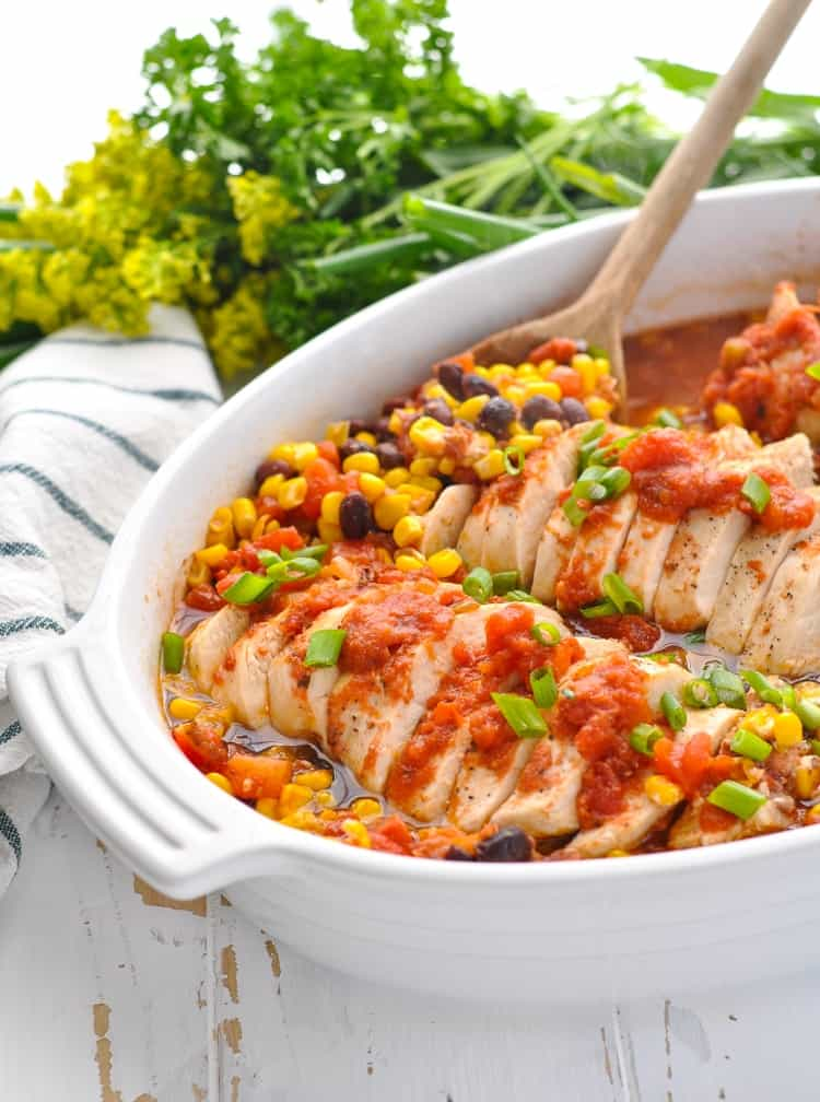 Casserole dish with salsa chicken breasts and corn and black bean salsa