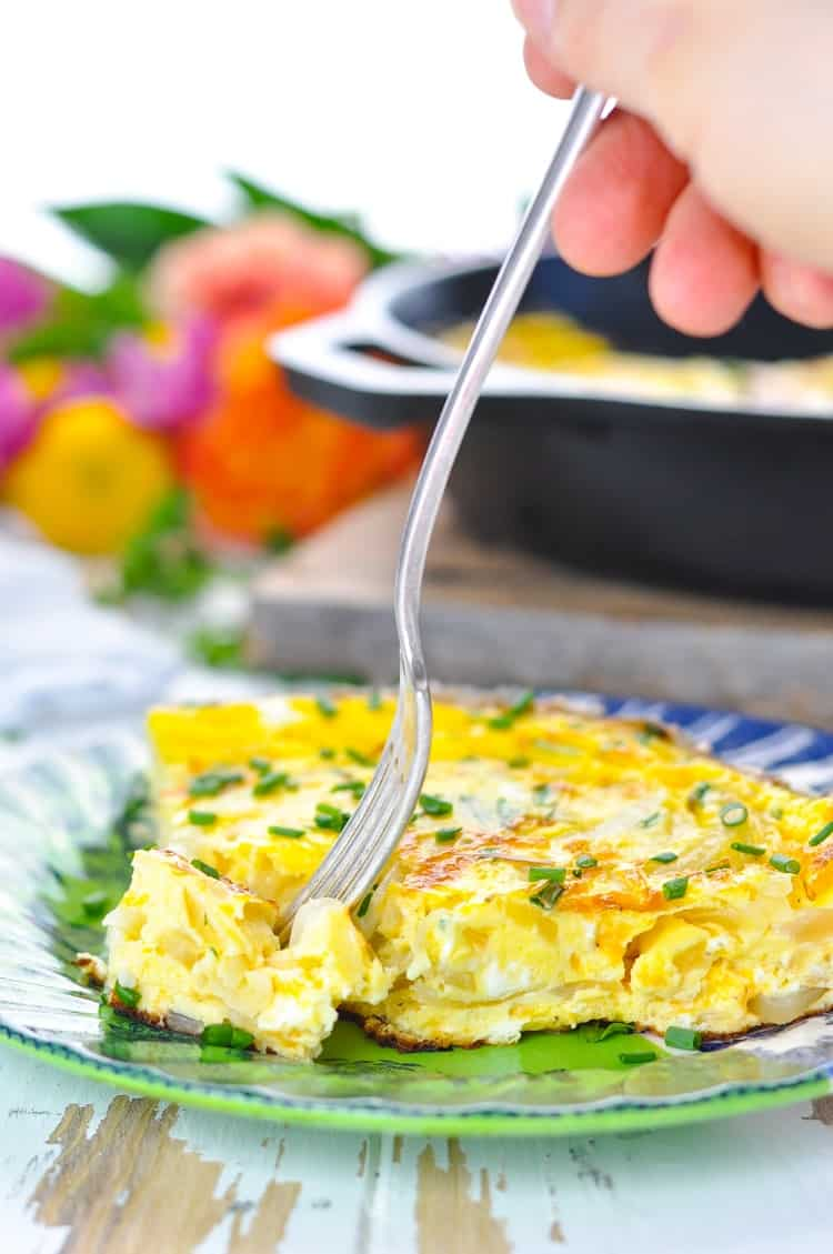 Fork taking a bite of an easy frittata