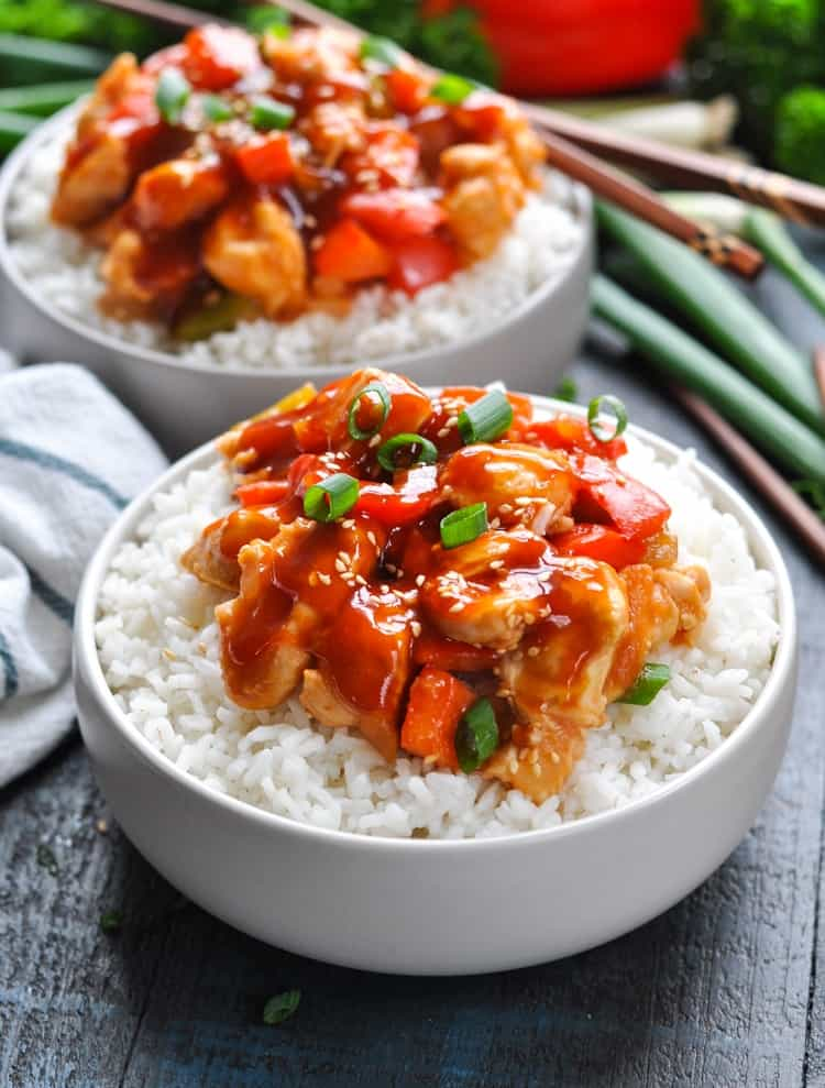 Bowls of rice with Sweet and Sour Chicken.