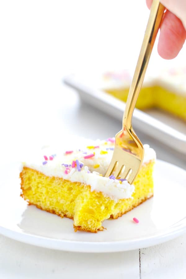 Fork taking a bite out of a lemon bar
