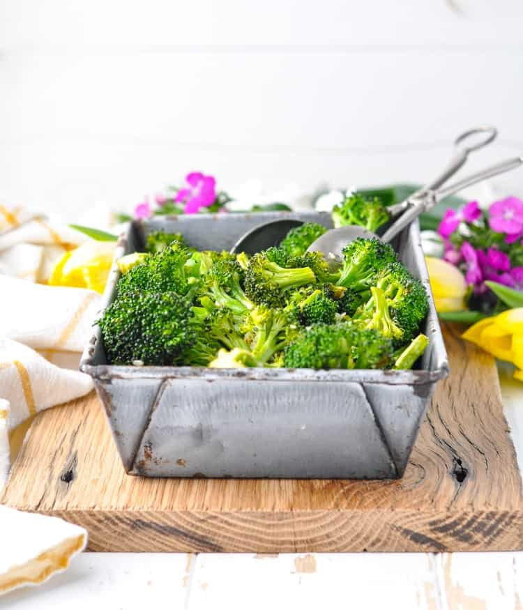 Small metal pan filled with crispy oven baked broccoli!