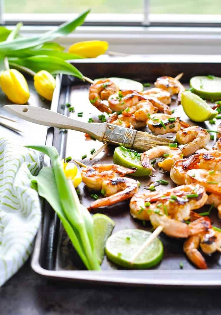 A tray of grilled shrimp kabobs basted in a honey lime marinade.