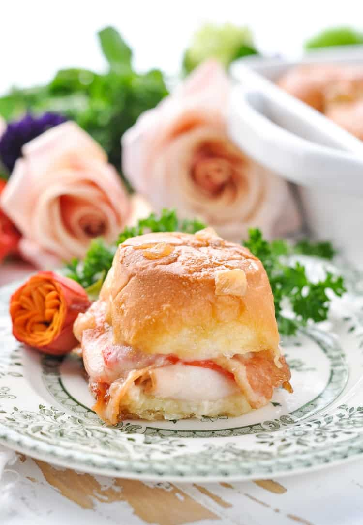 Kentucky Hot Brown Slider on a plate with roses in the background for a Derby Day party!