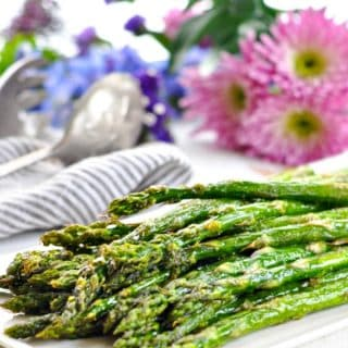 Oven roasted asparagus on a white serving platter
