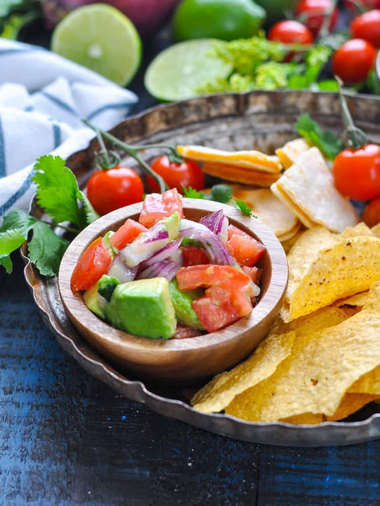 Party platter with quesadillas, chips and bowl of pico de gallo