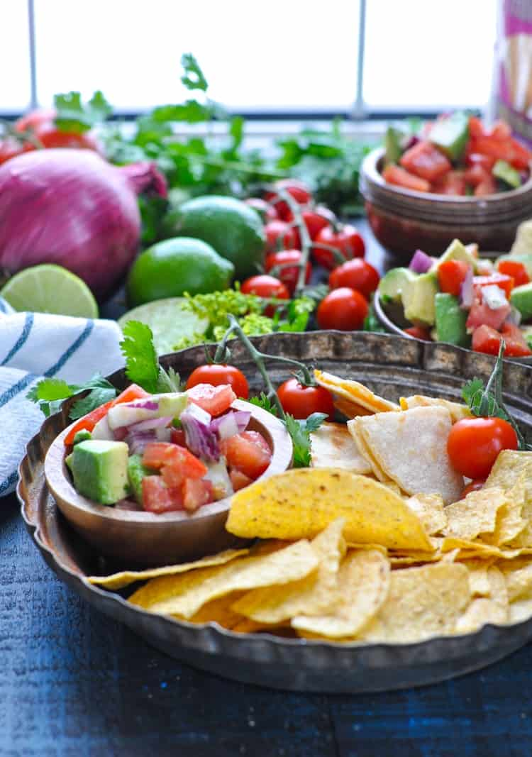 Party table with fresh pico de gallo and chips and quesadillas for dipping