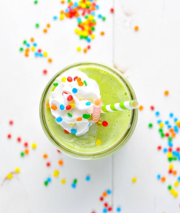 Close overhead shot of healthy shamrock shake with whipped cream and sprinkles on top