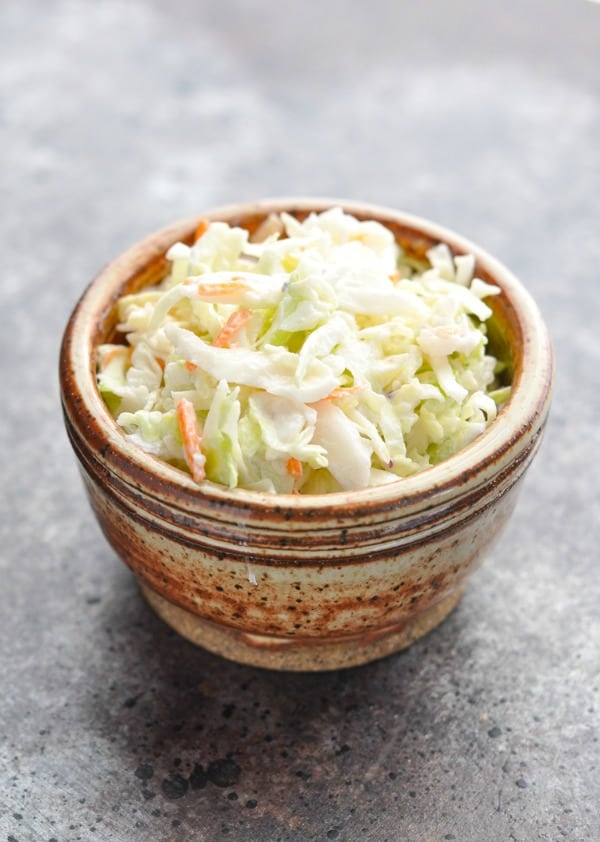 Bowl of cabbage slaw for shrimp tacos