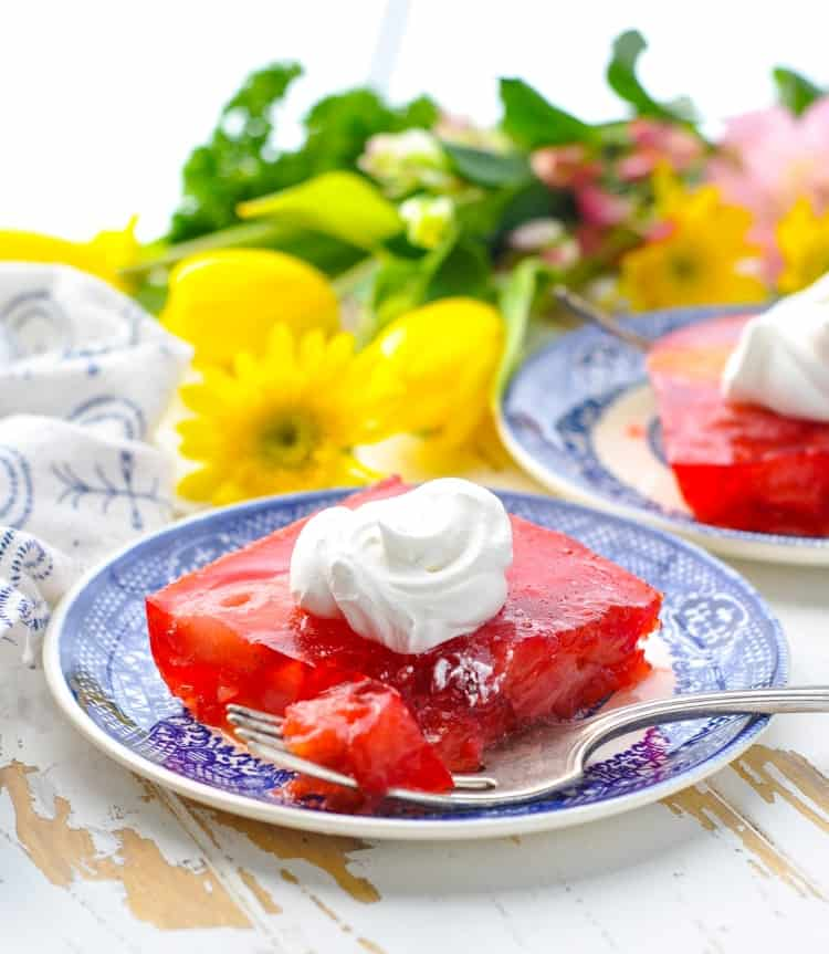 Strawberry Jello Salad with fork on a plate.