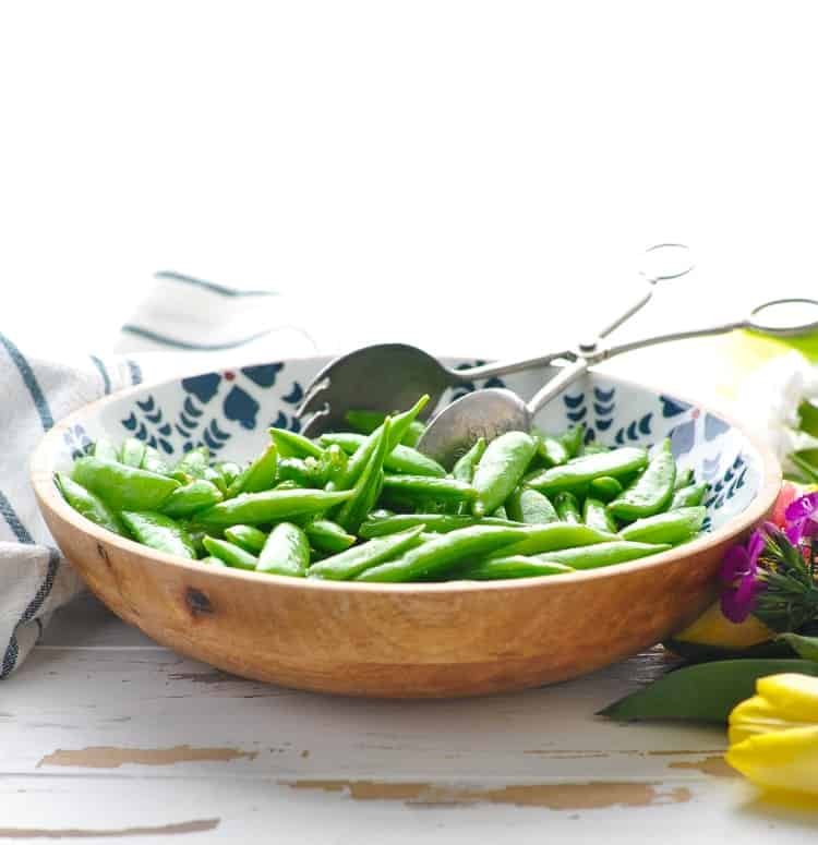 Bowl of cooked sugar snap peas for a healthy side dish salad