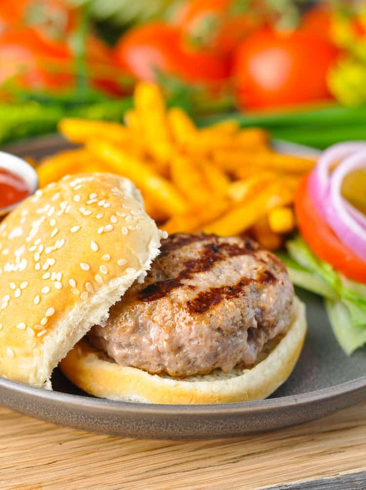 Grilled turkey burgers on a bun.