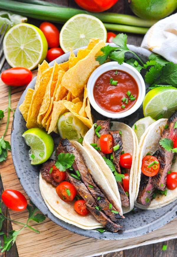 Plate of steak tacos made with Carne Asada grilled meat.