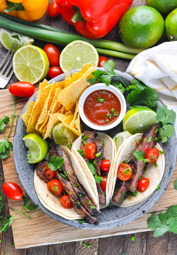 Plate of steak tacos made with carne asada.