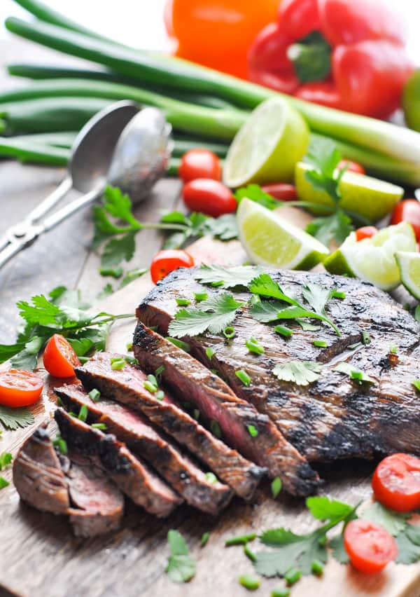 Grilled beef on a cutting board from a steak marinade for carne asada