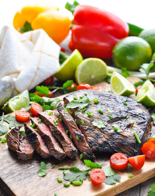 An easy grilled flank steak is transformed into juicy, tender, and flavorful Carne Asada -- with just 5 minutes of prep work!