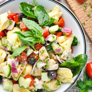 Overhead shot of a large bowl of tortellini salad