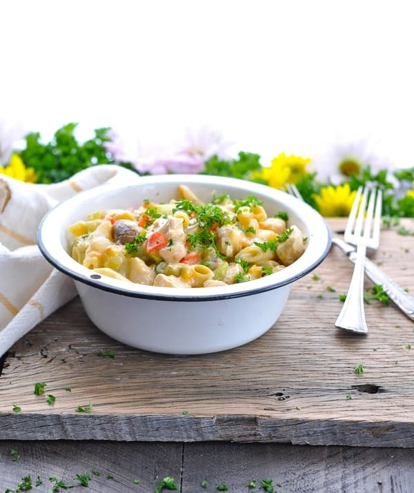 Bowl of quick prep dump-and-bake creamy chicken penne pasta casserole.