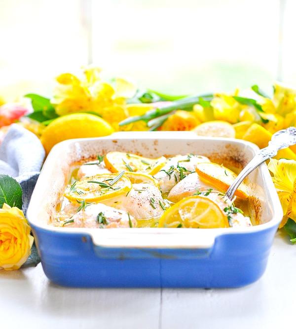 Healthy lemon chicken in a blue baking dish