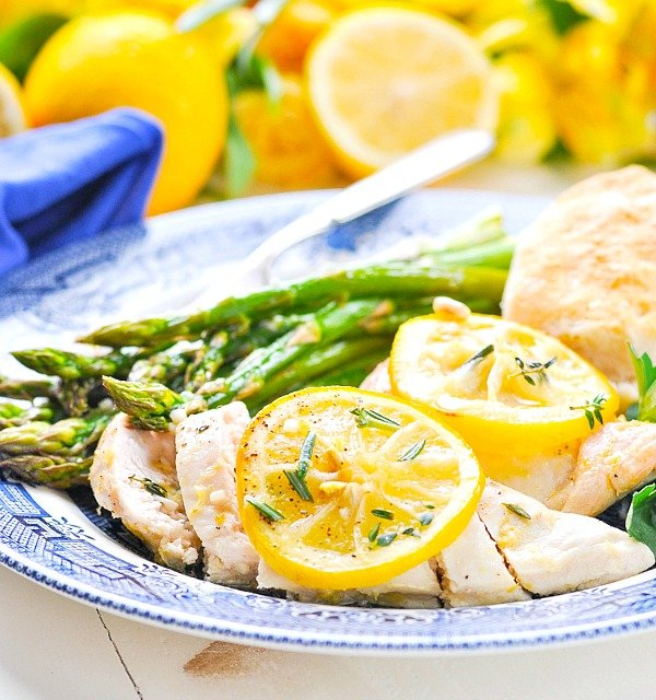 Baked lemon chicken on a plate with asparagus