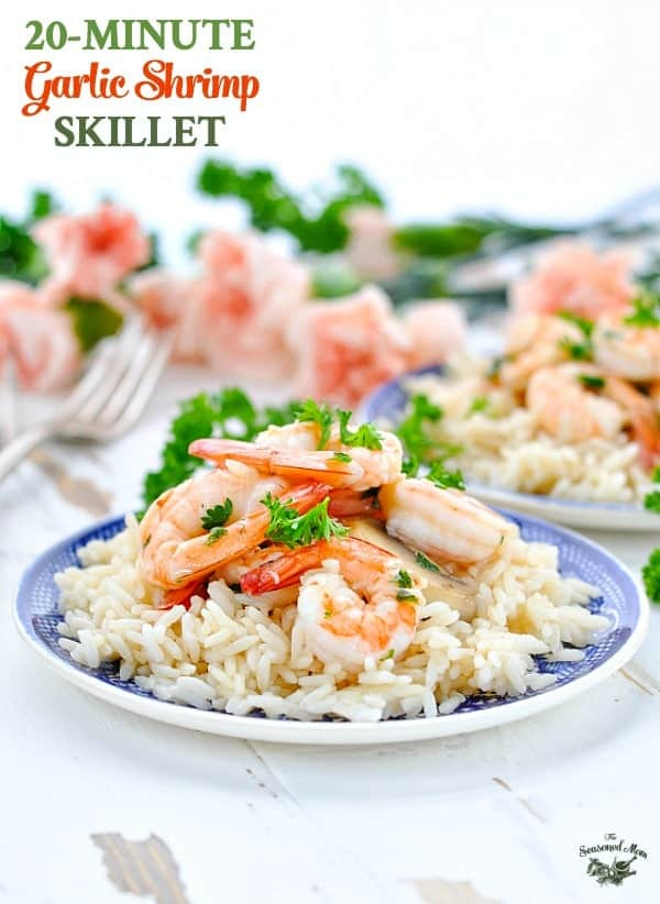 A healthy dinner of Garlic Shrimp served over rice and garnished with parsley.