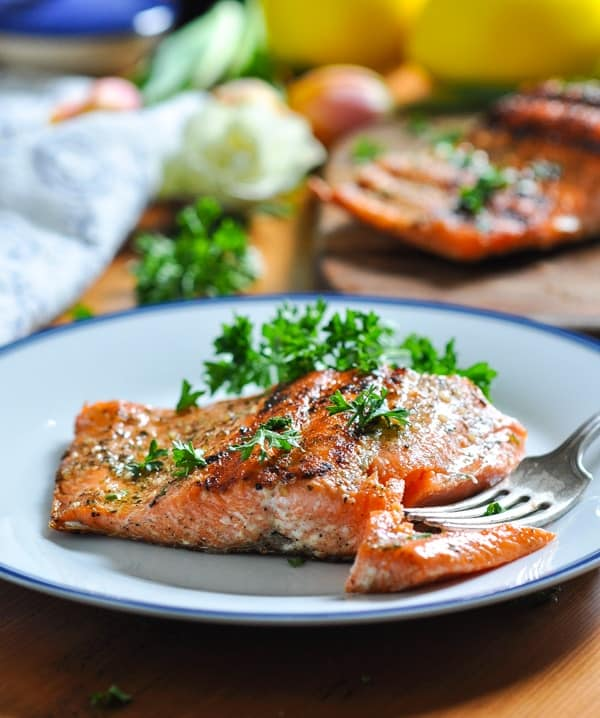 Easy and healthy grilled salmon on a plate with a fork.