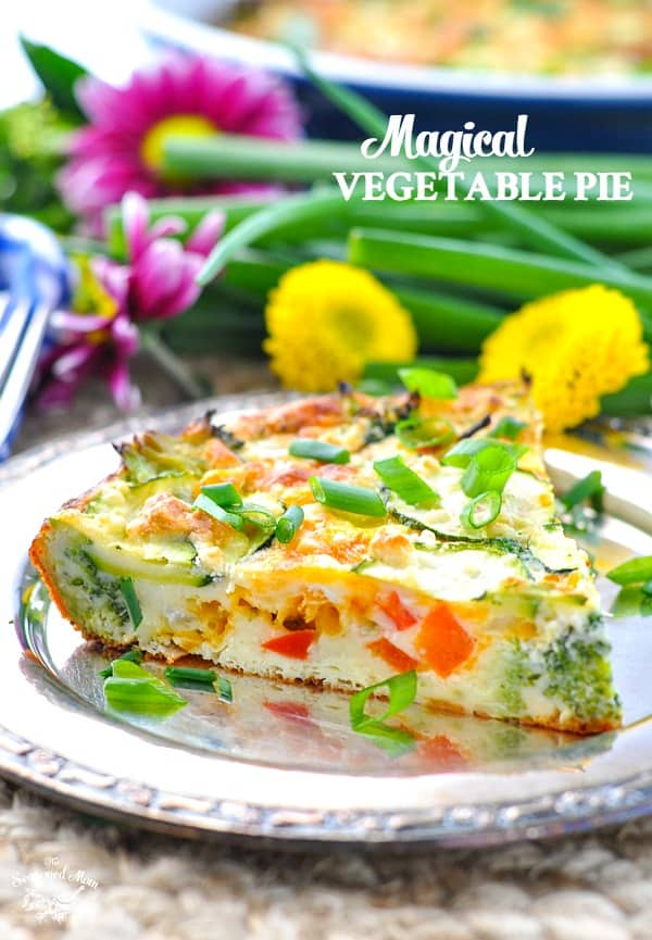 a slice of vegetable pie on a metal plate with flowers in the background