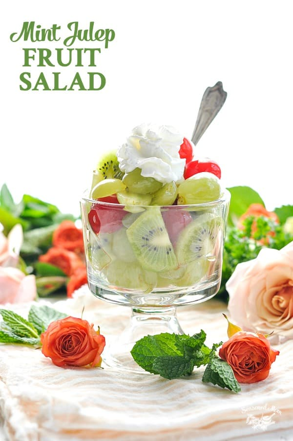 Grapes kiwi and cherries are dressed in a Mint and Lime Infused homemade dressing for this Mint Julep Fruit Salad!