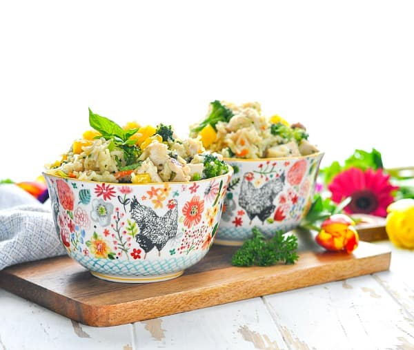 Bowls of chicken and rice with farmer's market vegetables that cook in one skillet!