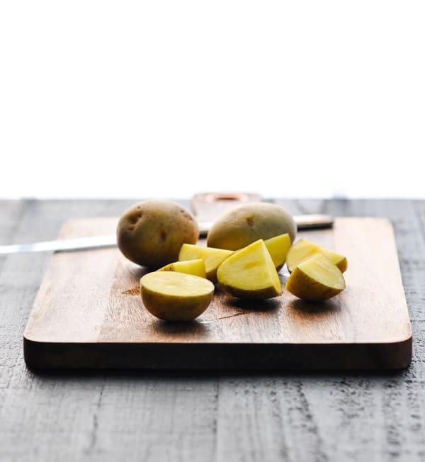 Baby potatoes on cutting board