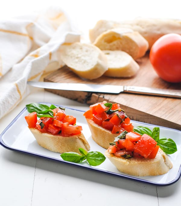 Tomato bruschetta is a fresh and healthy appetizer that you can make ahead for your next party!
