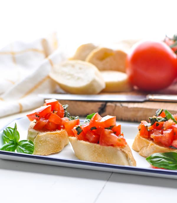 A tray of fresh tomato bruschetta is an easy summer appetizer recipe!