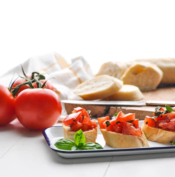Fresh and light easy appetizers like this tomato bruschetta are perfect for a summer party.