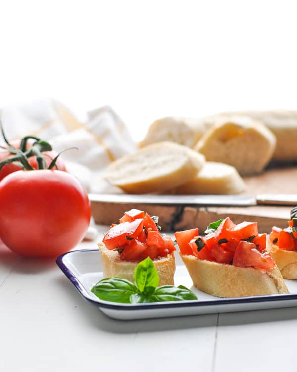 Toasted french baguette is the perfect base for tomato bruschetta antipasto