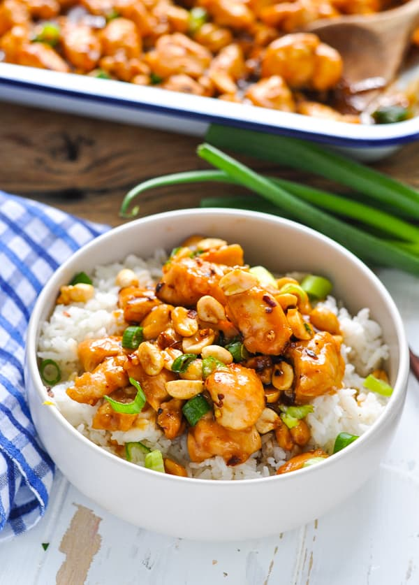 Bowl of Dump-and-Bake Kung Pao Chicken served with rice for an easy dinner.